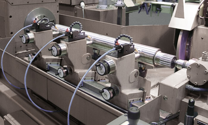 Table-top machine for Sendzimir rolls with two-point steady rests